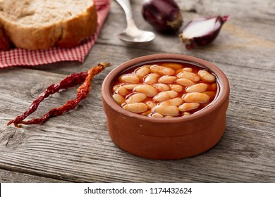 Baked Beans on wood background.