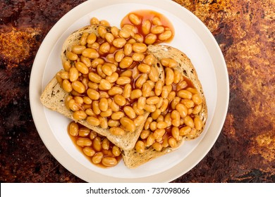 Baked Beans in Tomato Sauce on Toast On A Distressed Oven or Baking Tray