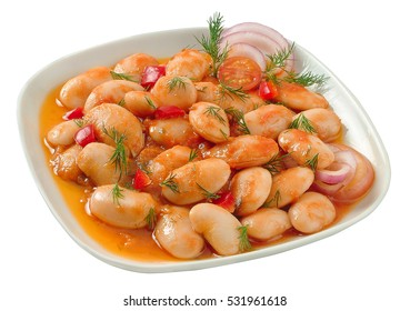 Baked beans in white plate, a traditional food for the fasting days.Clipping path