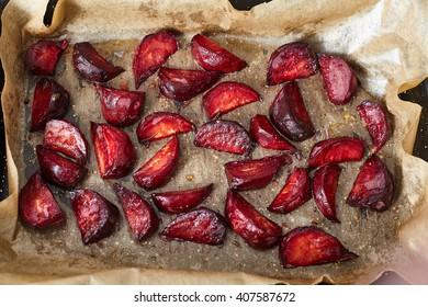 Baked beet with olive oil and salt inside oven in black pan with parchment paper