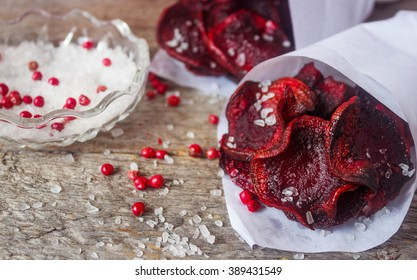 Baked beet slices. Healthy chips out of beets with sea salt and pink pepper. Selective focus