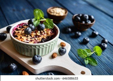 Baked blueberry crumble with oat flakes and chopped almonds