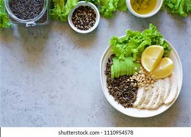 Baked breast, avocado, black rice, pine nuts and lettuce. Buddha bowl. Healthy Diet