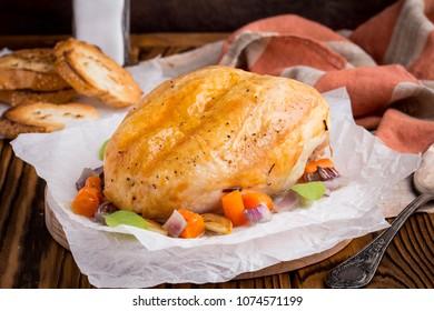 Baked chicken breast, brown crust, vegetables, tender meat