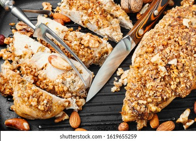 Baked chicken breast stuffed with various nuts in grill pan