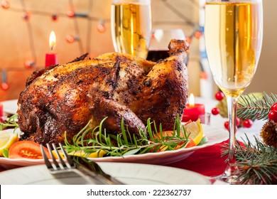 Baked chicken for Christmas dinner on festive table