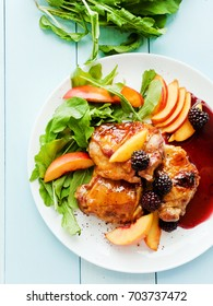 Baked chicken with fruits and greens. Shallow dof.