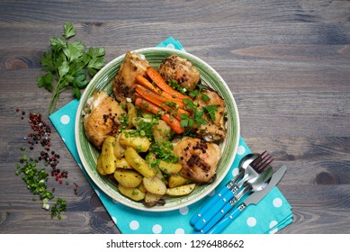 Baked chicken legs with potatoes and carrots under spices and seasonings. Place for text