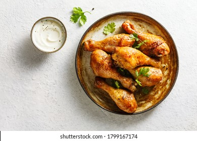 Baked chicken legs with spices and fresh herbs. Top view.