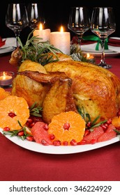 Baked chicken with mandarin, grapefruit, pomegranate at the Christmas table