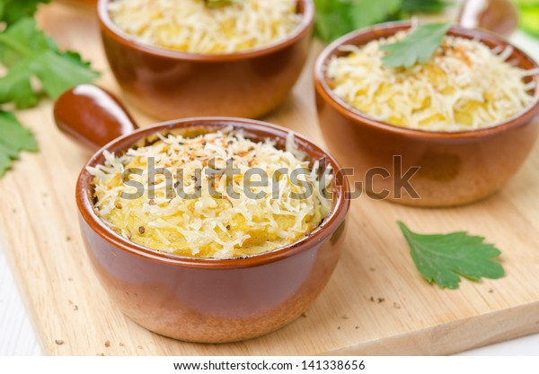 Baked chicken with mashed cauliflower and cheese in portions, closeup