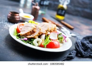 baked chicken with salad, chicken and vegetables, diet food, stock photo