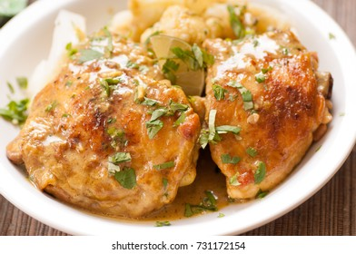baked chicken thighs with cauliflower and herbs, a ketogenic diet meal