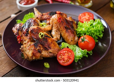 Baked chicken wings in the Asian style on plate.
