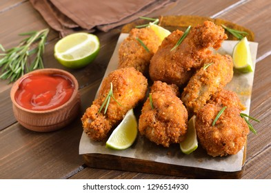 Baked chicken wings on a cutting board, close up