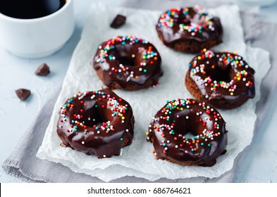 Baked chocolate doughnuts with chocolate glaze. toning. selective focus