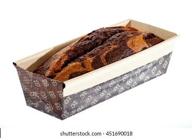 Baked chocolate and vanilla cake isolated on white.