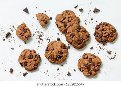 Baked Christmas cookies. Homemade Chocolate Chip Cookies on a light stone table. Top view flat lay background.