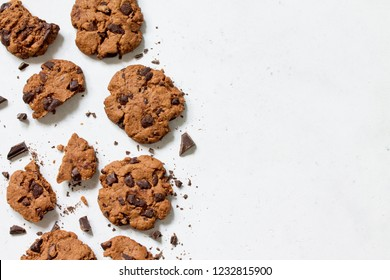 Baked Christmas cookies. Homemade Chocolate Chip Cookies on a light stone table. Top view flat lay background. Copy space.