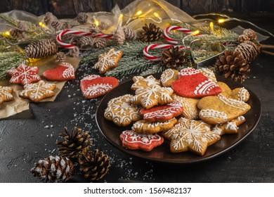 Baked Christmas cookies on rustic dark background.