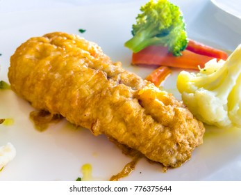 Baked cod in batter with vegetables steamed
