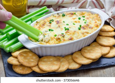 Baked crab dip, served with celery sticks and crackers, top view