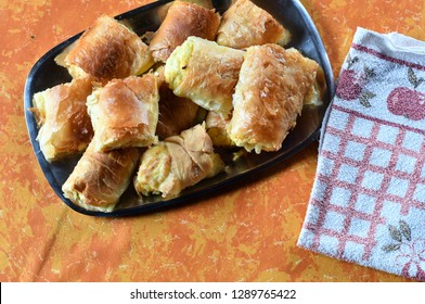 Baked curd cheese strudel on a kitchen table