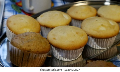 Baked delicacies of cupcakes and empanadas