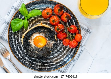 Baked egg and mushroom brunch with baby tomatoes - overhead view