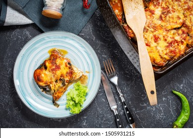 Baked eggplant with cheese on a stone table. Parmigiana melanzane. Italian cuisine.