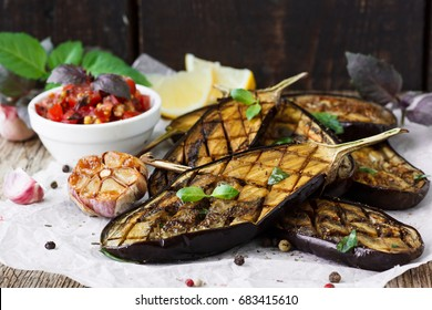Baked eggplant on a wooden background