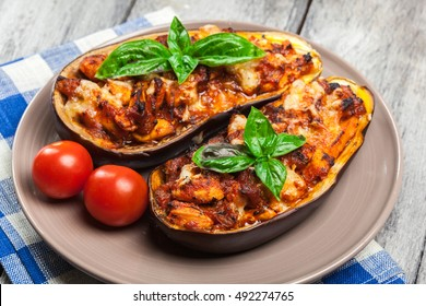 Baked eggplant with pieces of chicken in tomato sauce