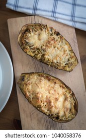 Baked eggplant stuffed with cheese, couscous and vegetables