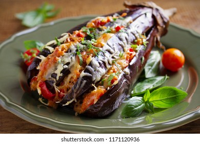 Baked eggplant, stuffed with meat, tomatoes, paprika, onion and cheese. Aubergine with meat and vegetables