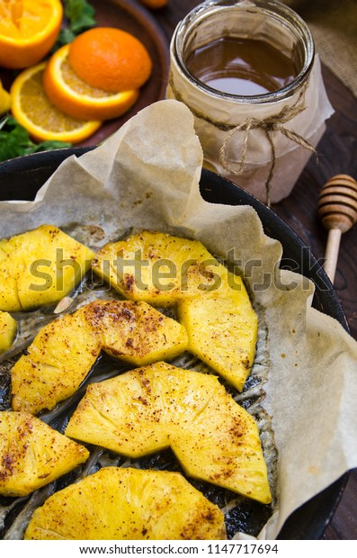 Baked exotic fruit, baked pineapple with cinnamon and honey, mint, oranges, passion fruit, granadil, roumbutan