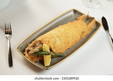 baked fish in salt, with lemon and rosemary