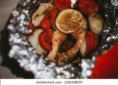 baked in foil salmon steak with vegetables tasty and healthy food