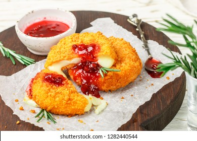 Baked or fried Camembert or brie cheese with cranberry and rosemary sauce. Gourmet Breakfast. Selective focus