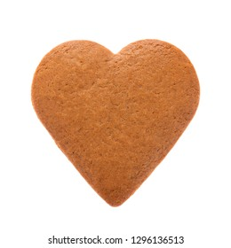 Baked gingerbread from shortbread in the form of a heart. Isolated on white background. Attribute of Valentine's Day