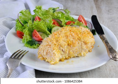 Baked to a golden, crispy crust chicken roll in breadcrumbs with parmesan and garnish of vegetables.