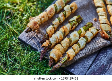 Baked green asparagus in puff pastry sprinkled. Natural light.