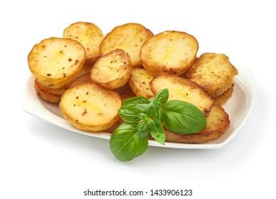 Baked halves of Potatoes, close-up, isolated on white background.