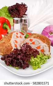 Baked ham on a white plate with fennel, parsley and lettuce