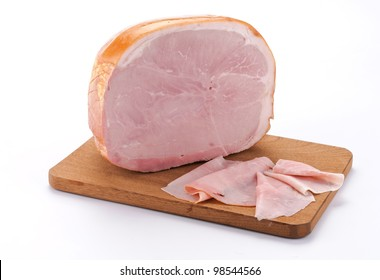 Baked ham with slices on wooden board