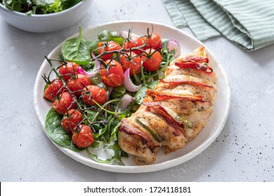 Baked hasselback chicken breast stuffed with bacon, cheese and jalapenos