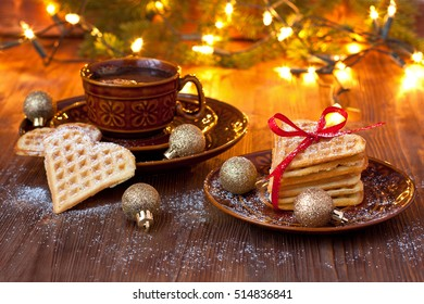 Baked heart waffles with coffee cup, christmas composition