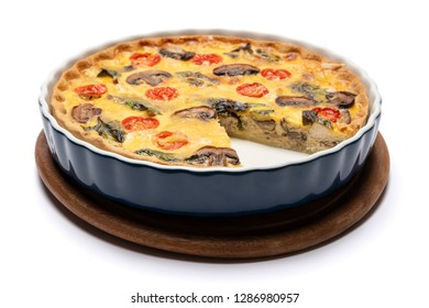 Baked homemade quiche pie in ceramic baking form