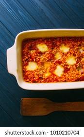 Baked Italian rice (risotto) al forno with tomato sause and mozarella