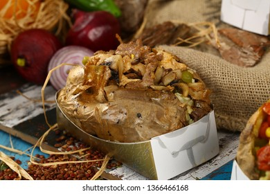 Baked kumpir potato with beef meat and chicken meat