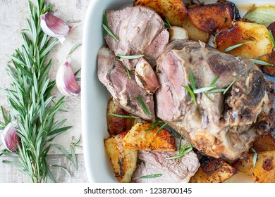 Baked lamb leg and potatoes.